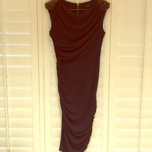 Midi length navy dress with spiked shoulders.